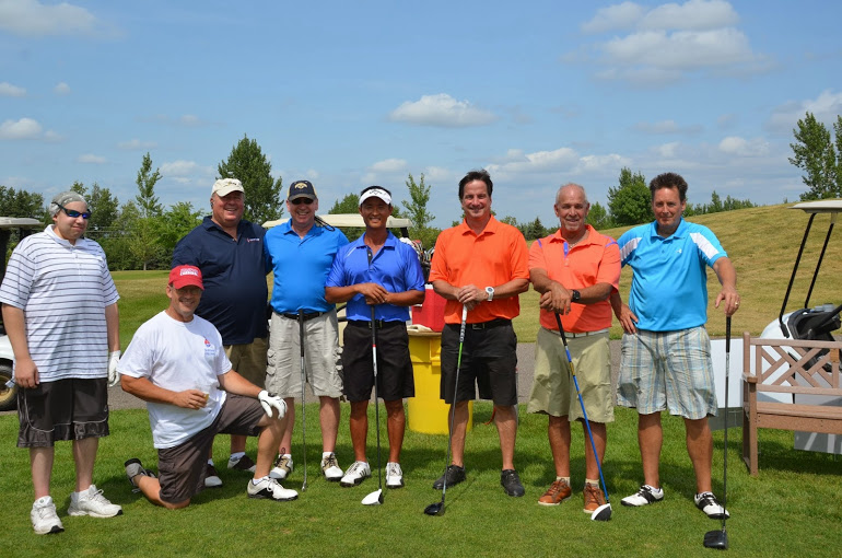 A group of 8 guys golfing